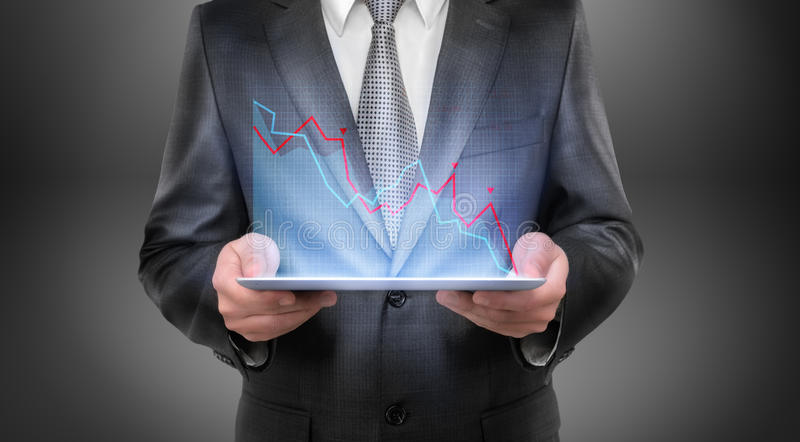 Cropped portrait of a businessman holding tablet with falling diagram above it stock images