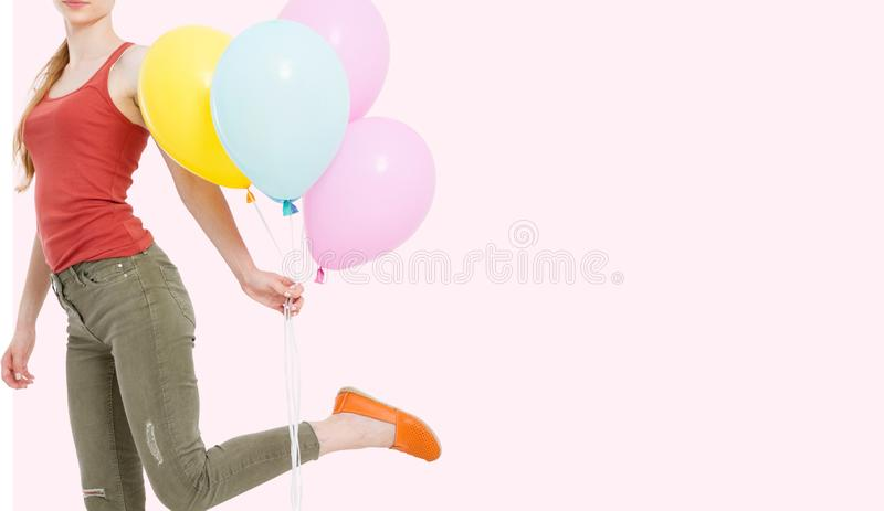 Cropped portrait of women with colored balloons isolated on pink background stock images