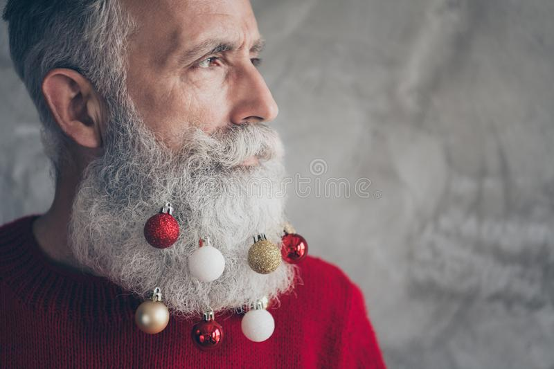 Cropped profile side photo of masculine brutal old man look elegant prepare for christmas time party hang x-mas baubles. Cropped profile side photo of masculine royalty free stock image