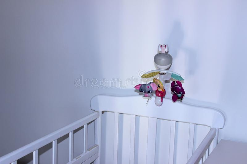 White Baby Bed For Newborn Over White Wall Background. White Interior For Baby Boom. stock photos