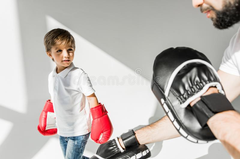 Father and son boxing together royalty free stock photography