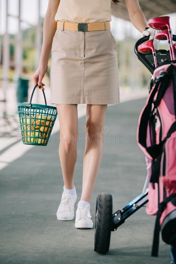 cropped shot of female golf player with golf equipment stock photography