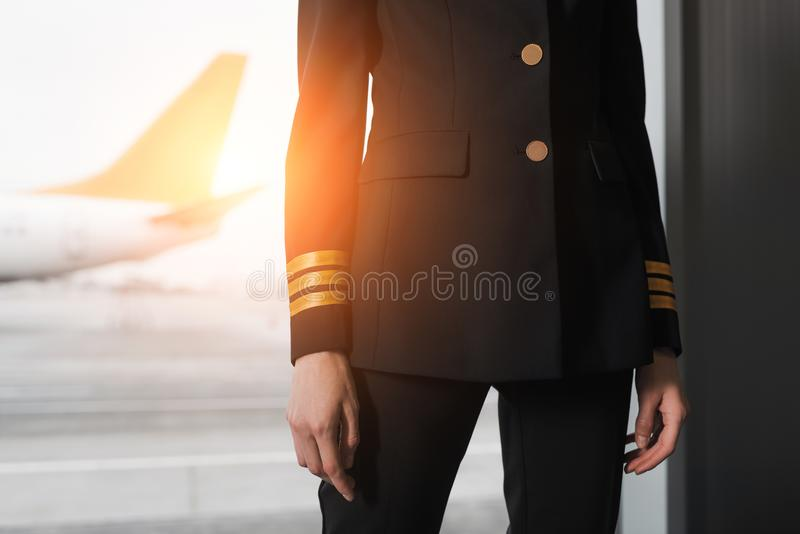 Cropped shot of female pilot. In professional uniform royalty free stock photos