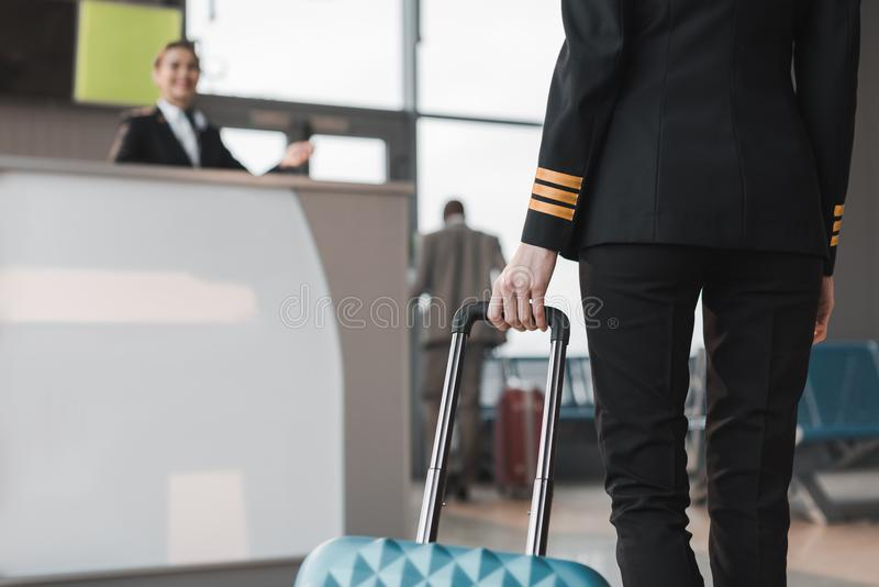 cropped shot of female pilot with suitcase stock photos