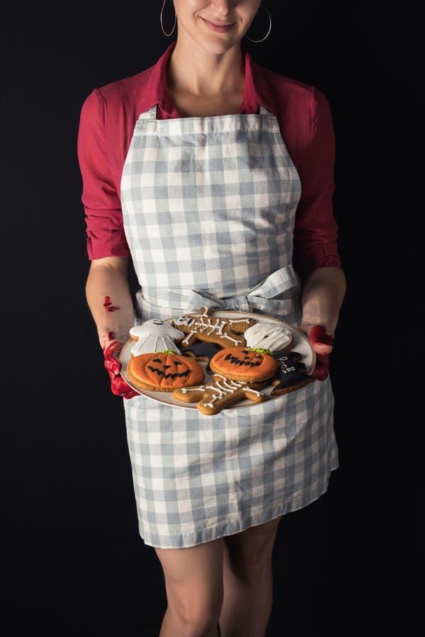 girl with halloween cookies stock photo