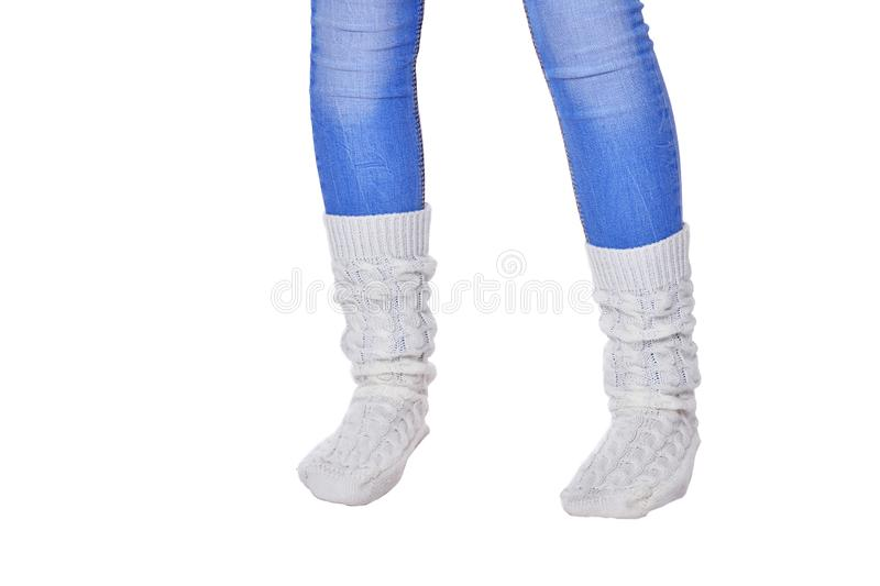 Cropped shot of girl wearing blue jeans and white socks on white background stock photo