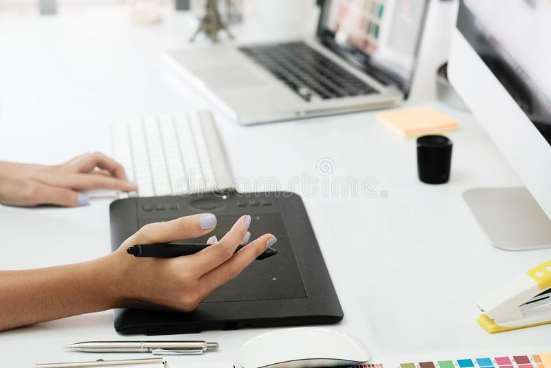 Graphic design desk hand using mouse pan sketch device. Cropped shot graphic design desk hand using mouse pan sketch device on creative desk stock photos