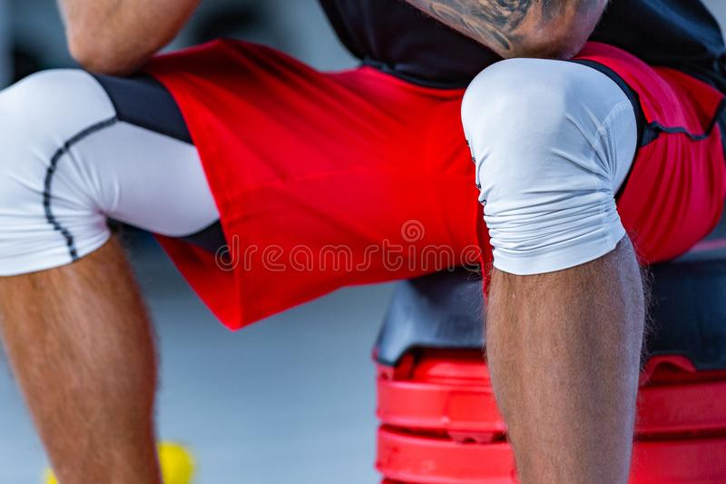 Cropped shot of a handsome mature fitness man with perfect toned body working out at the gym. royalty free stock photo