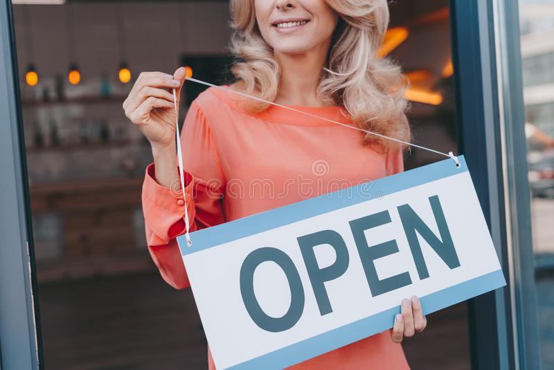 cropped shot of happy small business owner holding sign stock images