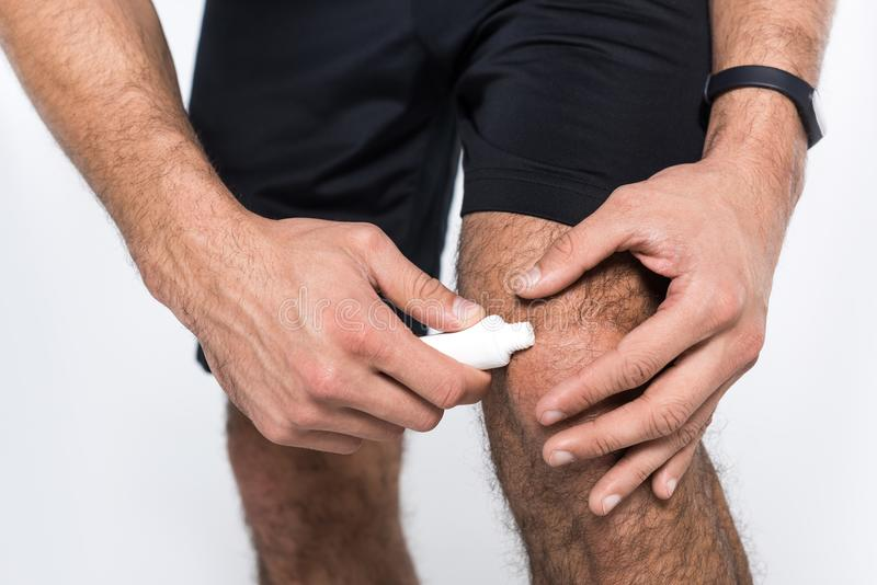 cropped shot of man applying ointment royalty free stock photos
