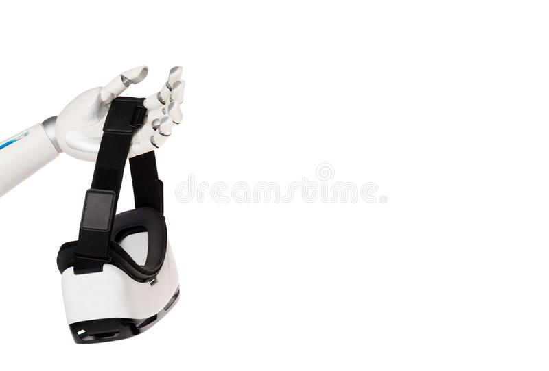 cropped shot of robot holding vr headset stock photo