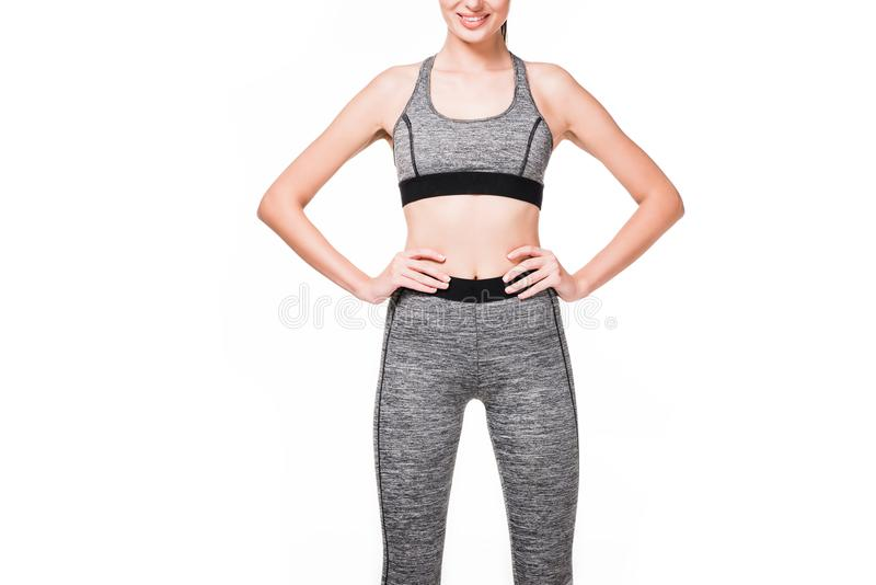 cropped shot of smiling sportswoman standing with hands on waist royalty free stock photography