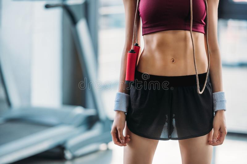 Cropped shot of sportswoman with skipping rope. At gym stock images