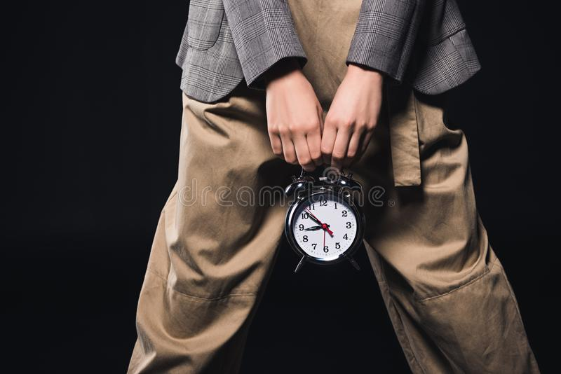 cropped shot of stylish woman holding clock vector illustration