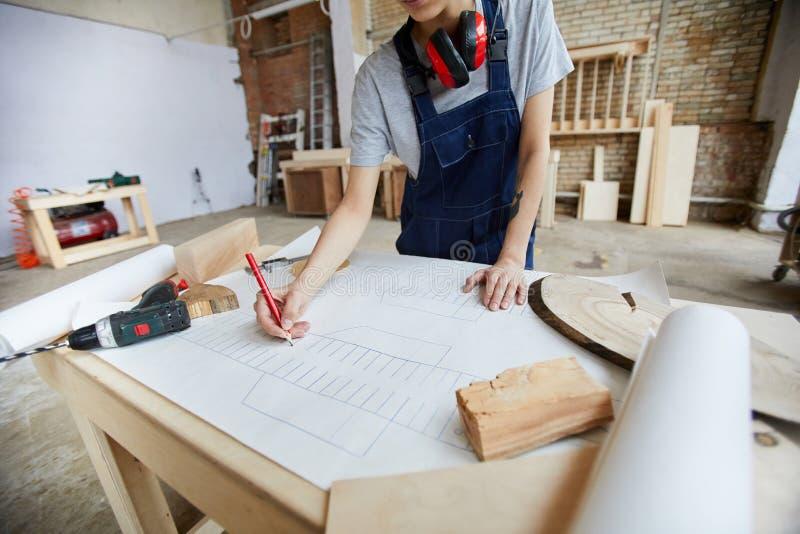 Carpenter Drawing Plans royalty free stock photos