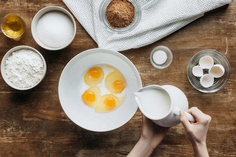 cropped shot of woman mixing eggs and milk stock images