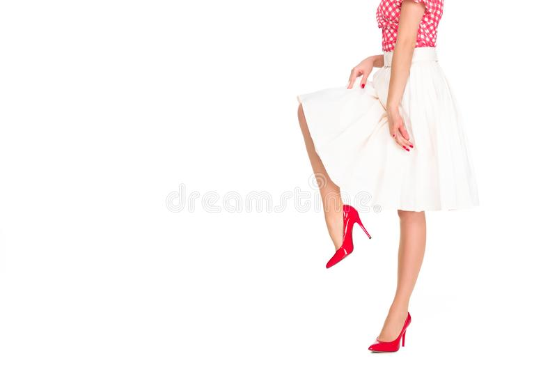 Cropped shot of woman in red high heels and skirt. Isolated on white royalty free stock photos