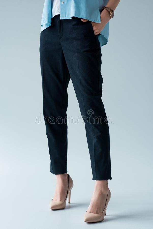 cropped shot of woman in stylish pants and high heels royalty free stock images