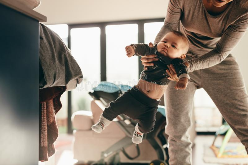 Mother playing with her baby at home stock photography