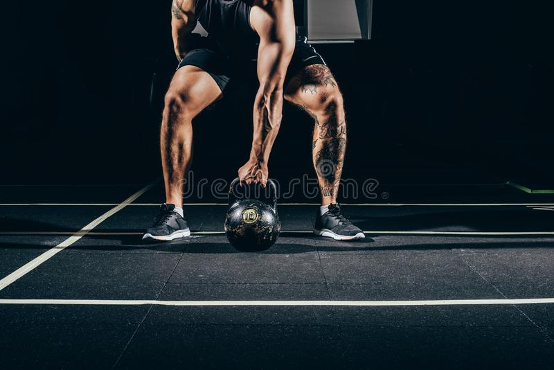 Cropped shot of young athletic sportsman royalty free stock photo