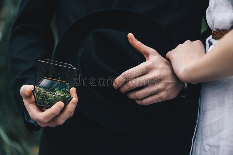 Cropped shot of young couple standing together and man. Holding jewelry box with engagement ring stock images