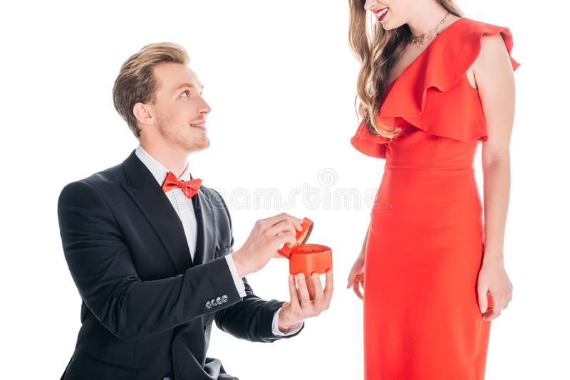 Man proposing to woman. Cropped shot of young men proposing to women isolated on white stock photography