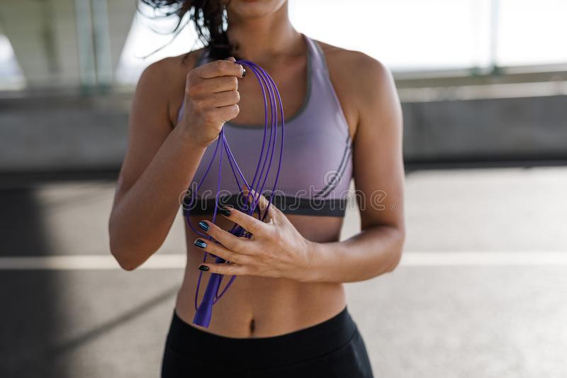 Cropped shot of young sporty woman royalty free stock photo
