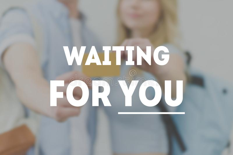 cropped shot of young students holding golden card, waiting for you inscription stock photo