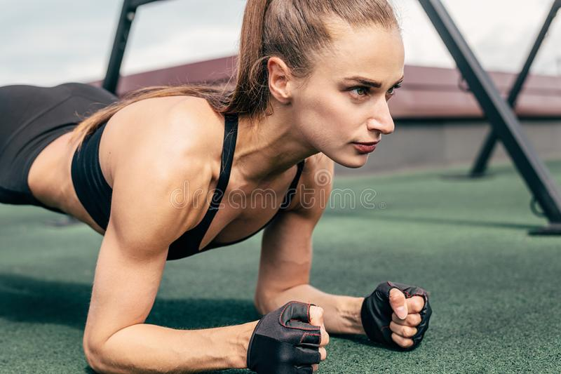 Cropped shot of a young woman doing planking exercise royalty free stock photography