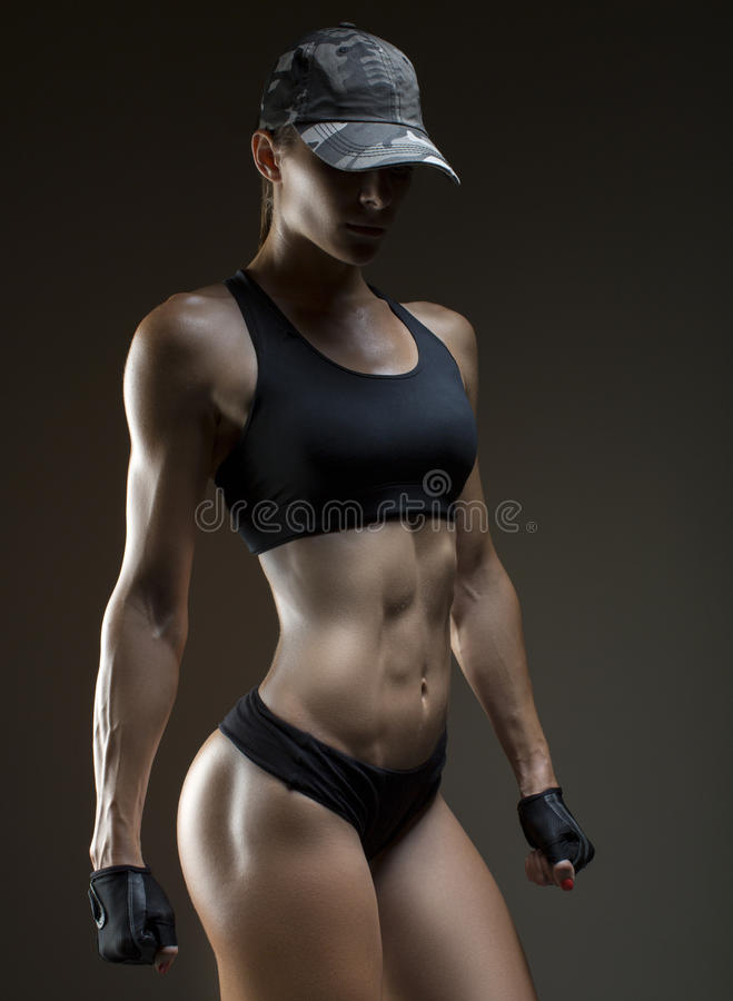 Free Cropped Studio Shot Of A Stunning Hot Sporty Body Of A Fitness Woman Royalty Free Stock Images - 83651099