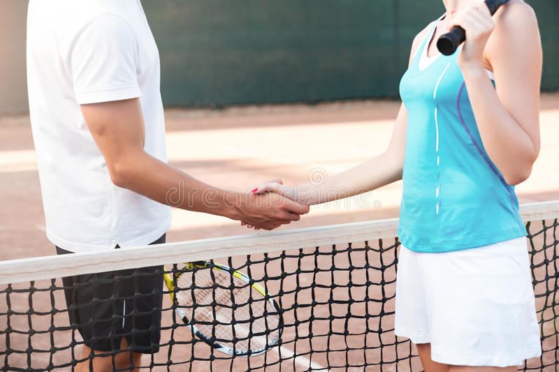 Cropped tennis players stock photos