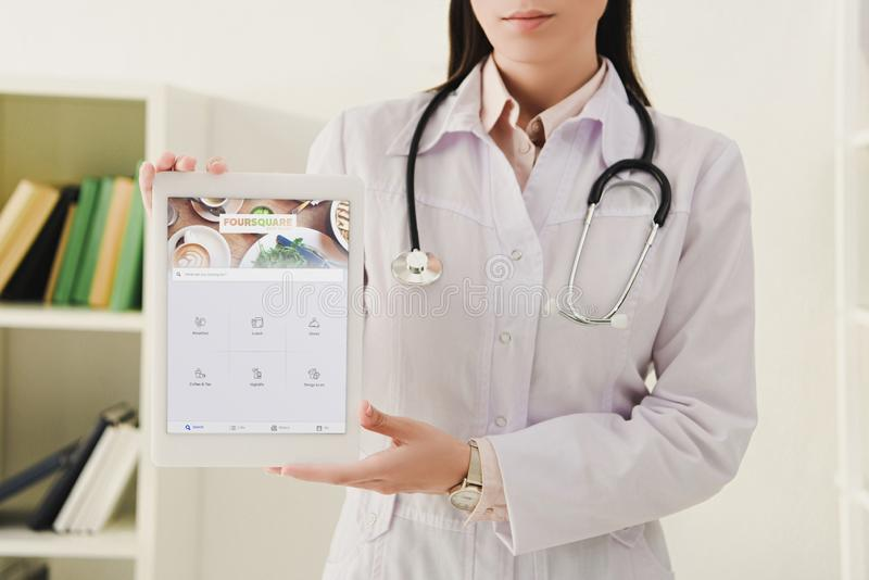 cropped view of doctor presenting digital tablet royalty free stock images