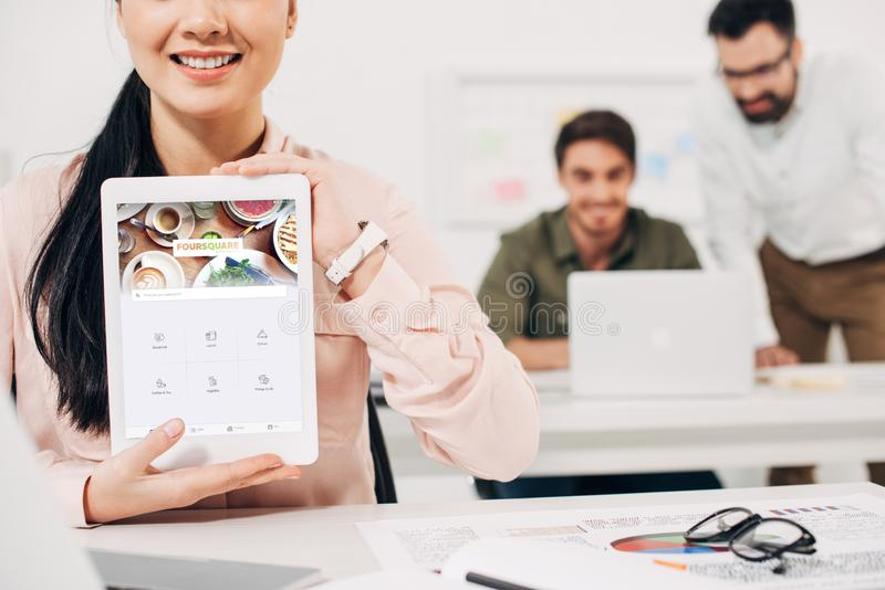 Cropped view of female manager showing digital tablet royalty free stock image