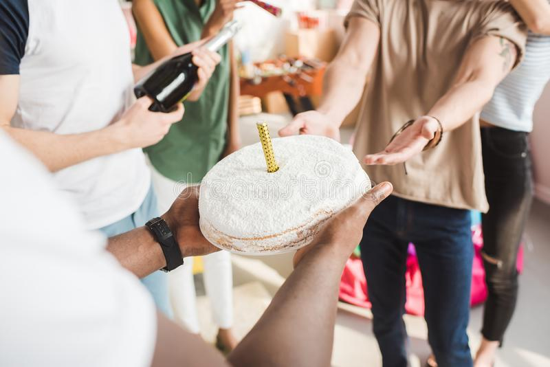 Cropped view of people celebrating birthday with cake royalty free stock image