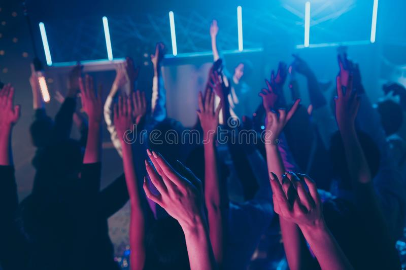 Cropped view photo blurred of large group people raise hands enjoy disco discotheque dance floor stock photos