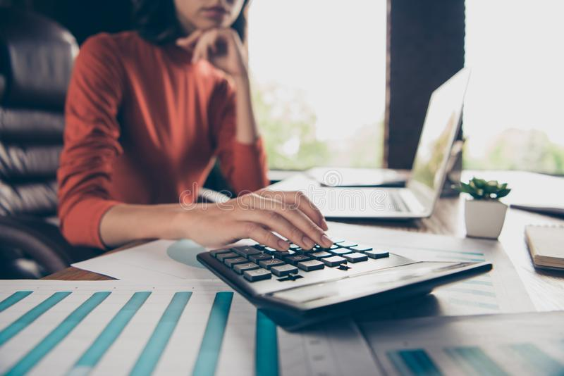 Cropped view photo of charming nice lady chief boss count trade calculate profit table desk think thoughtful ponder royalty free stock image