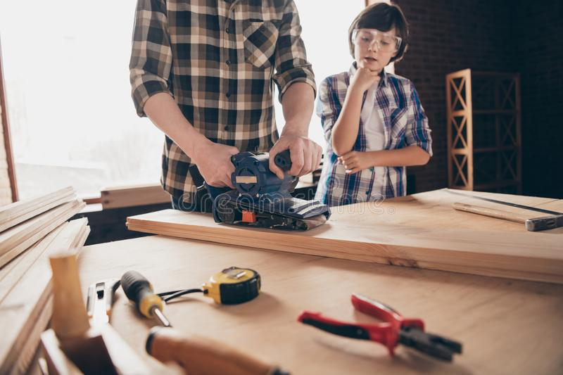 Cropped view of two nice creative person master handyman artisan dad fixing creating construction showing teaching son stock photos