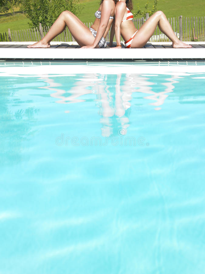 Cropped View Of Two Women By Pool Royalty Free Stock Image