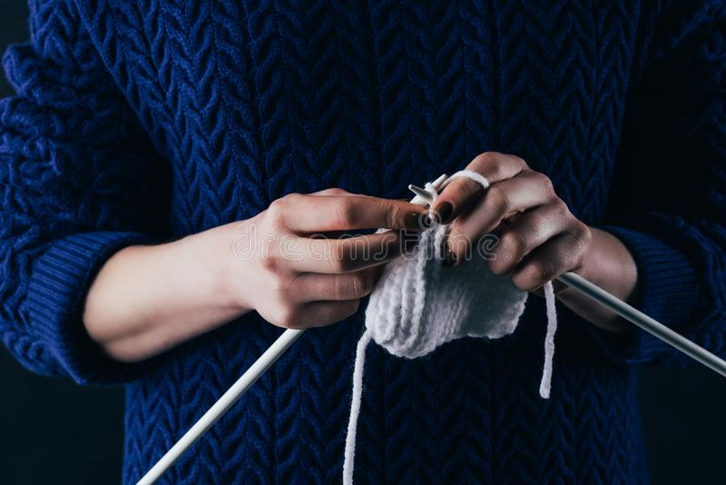 Cropped view of woman knitting wool with needles royalty free stock images