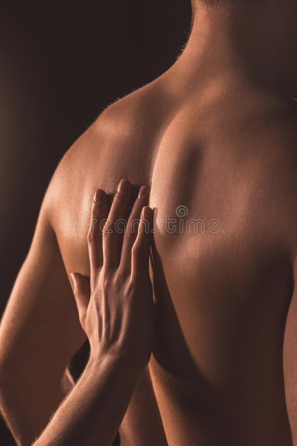 cropped view of woman touching back of her lover, royalty free stock photography