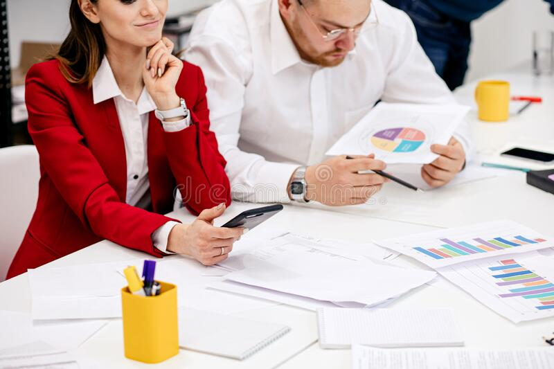 Cropped young business people in office royalty free stock photo