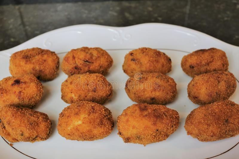 Croquettes fried in olive oil royalty free stock photography