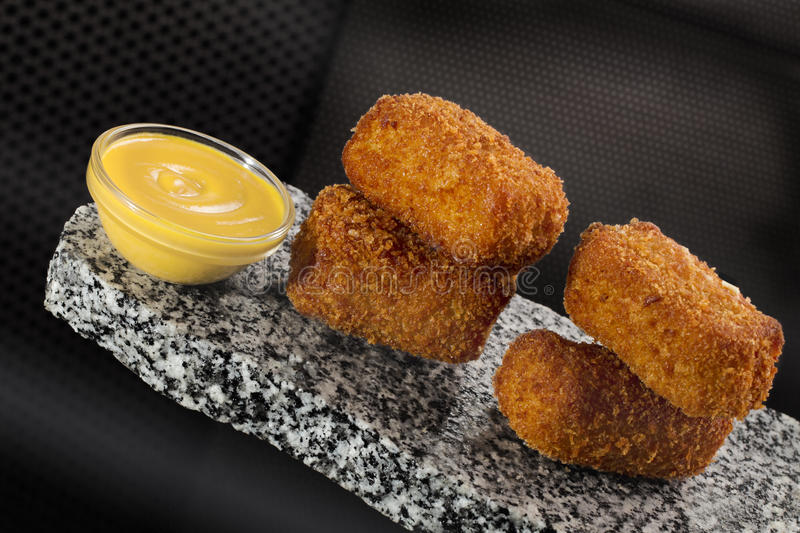 Croquettes with sauce royalty free stock image