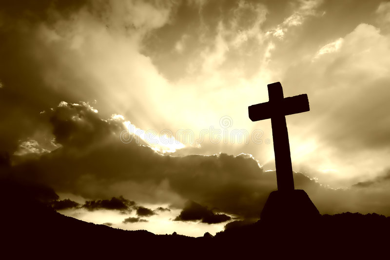 Cross. Detail in silhouette and the clouds in the sky stock image