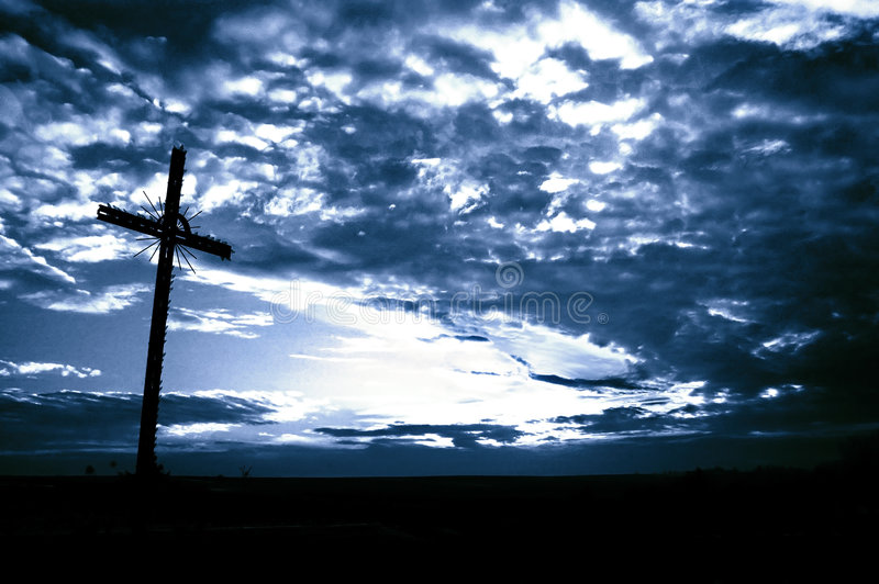 Cross. Detail in silhouette and the clouds in the sky stock photos