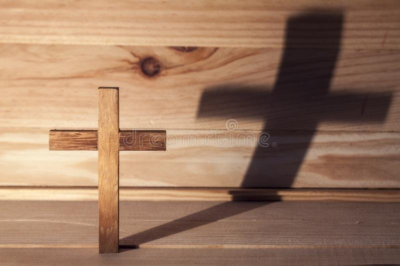 Cross. Over wood table with shadow stock photos