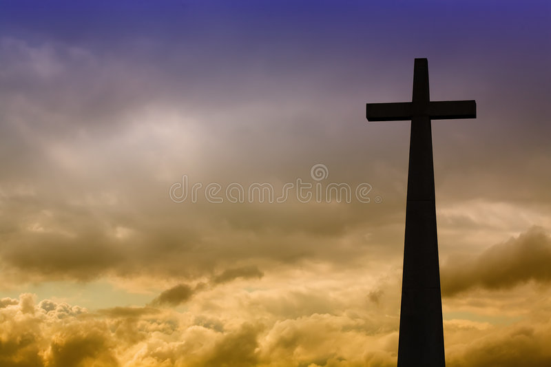 Cross. Detail in silhouette and the clouds in the sky