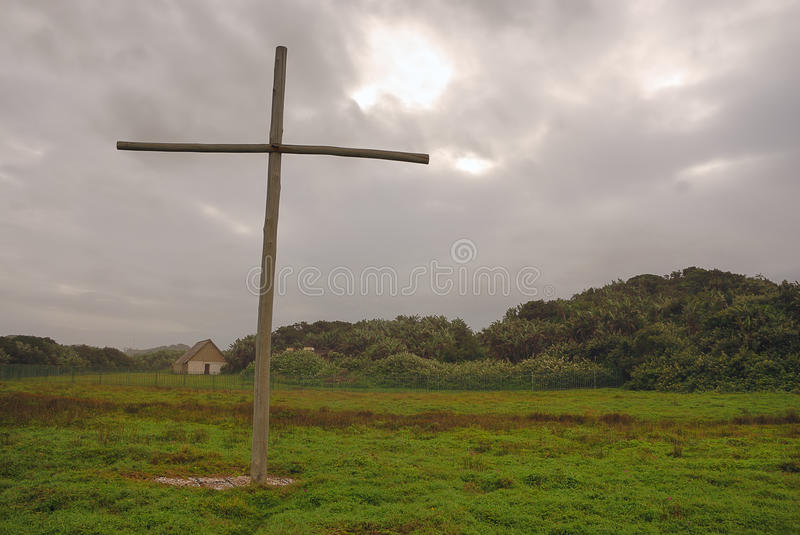 Cross against stormy sky
