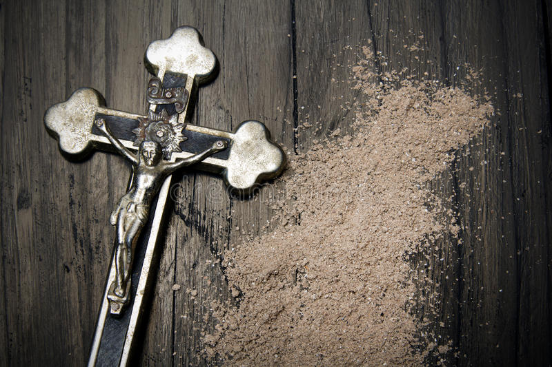 Cross and ash - symbols of Ash Wednesday.  stock photos