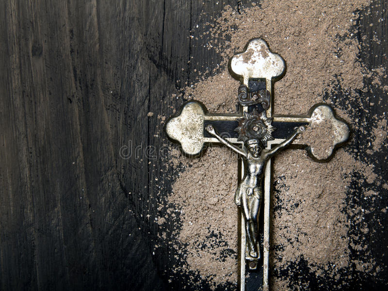 Cross and ash - symbols of Ash Wednesday.  stock photography
